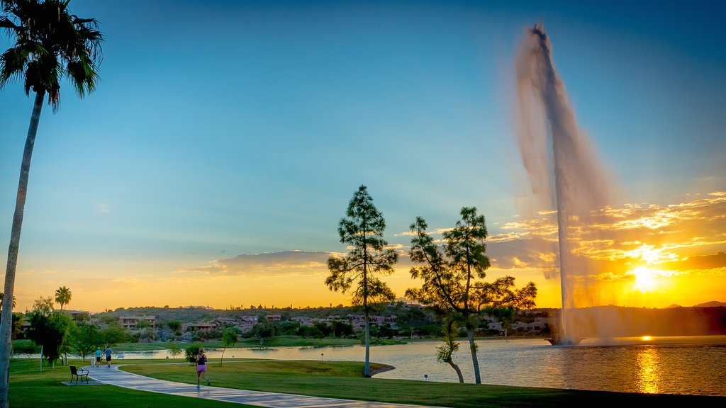 Fountain Hills showing a sunset, a fountain and a lake or waterhole