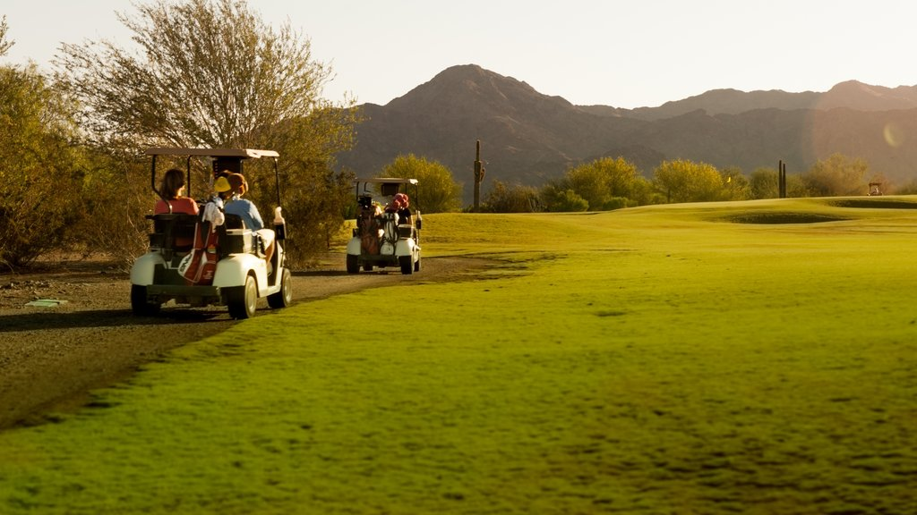 Yuma featuring mountains and golf as well as a small group of people