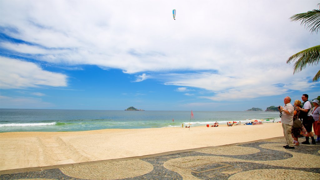 Zona Sul showing a sandy beach and general coastal views as well as a small group of people