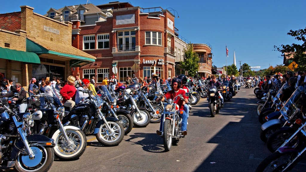 Fayetteville featuring motorbike riding as well as a large group of people