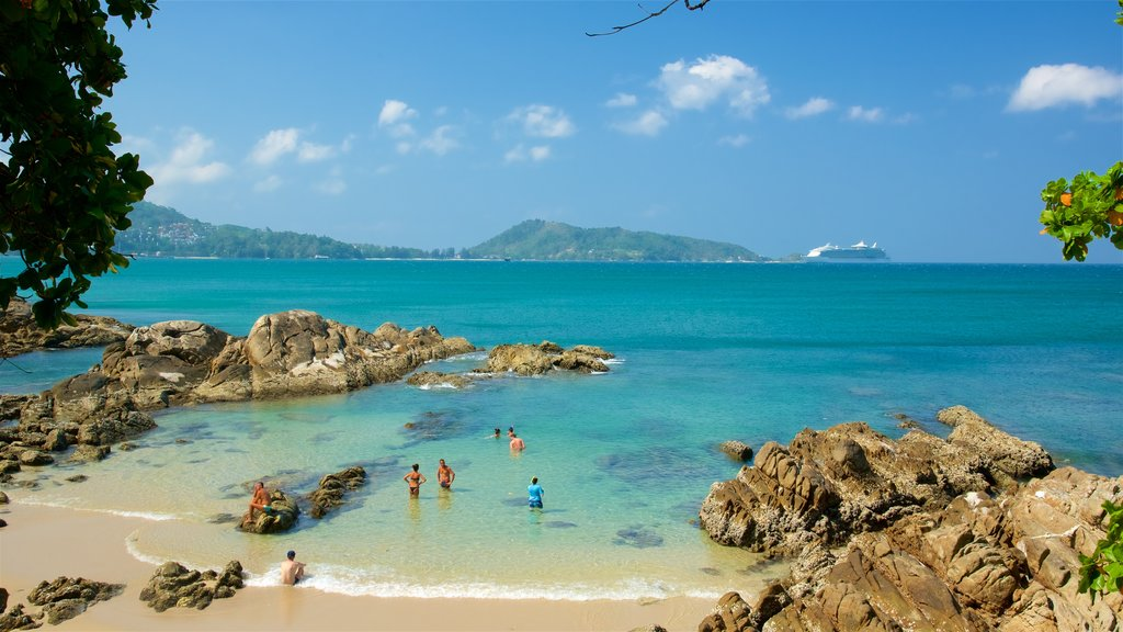 Patong showing a sandy beach, general coastal views and rocky coastline