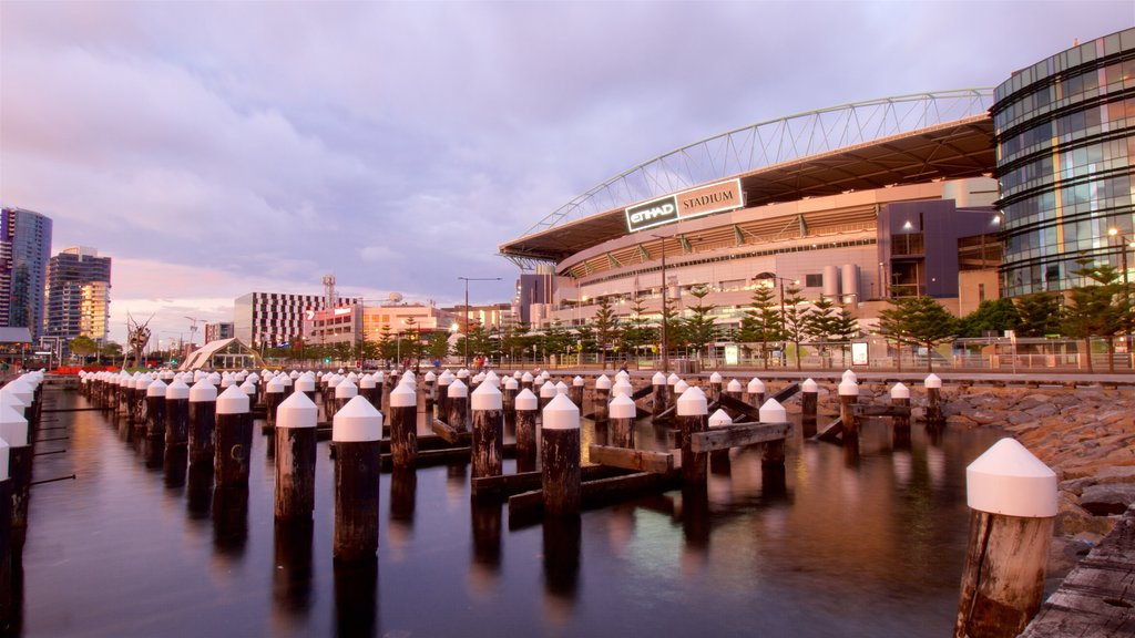 Docklands showing city views, a sporting event and a river or creek
