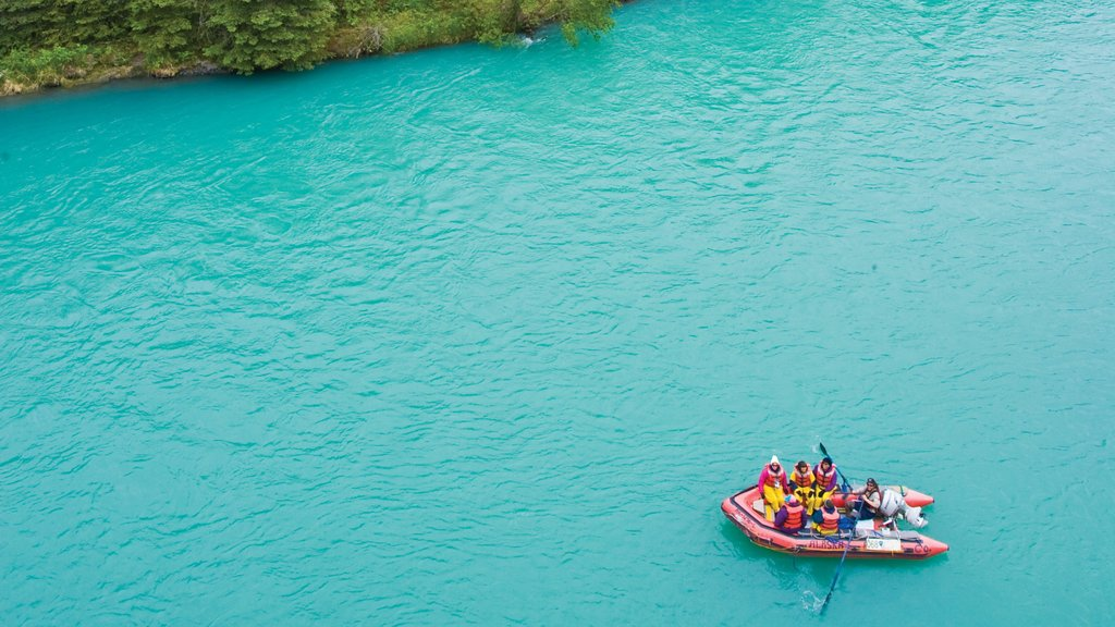 Kenai Peninsula featuring a lake or waterhole and rafting as well as a small group of people
