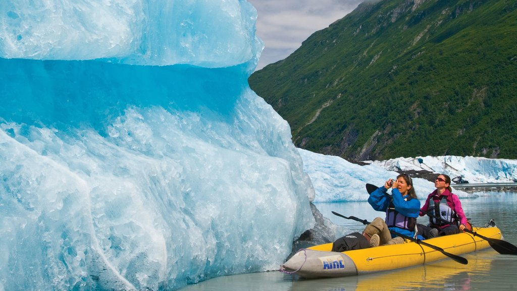 Valdez featuring mountains and kayaking or canoeing as well as a small group of people