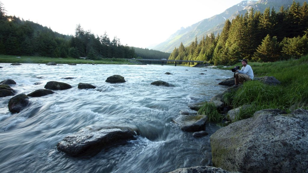 Haines featuring a river or creek and tranquil scenes as well as an individual male