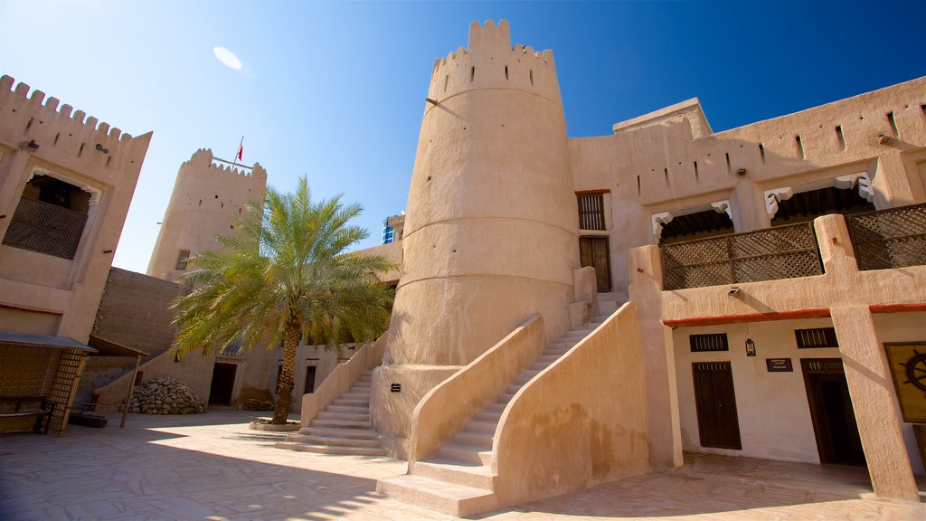 Ajman featuring desert views and heritage architecture