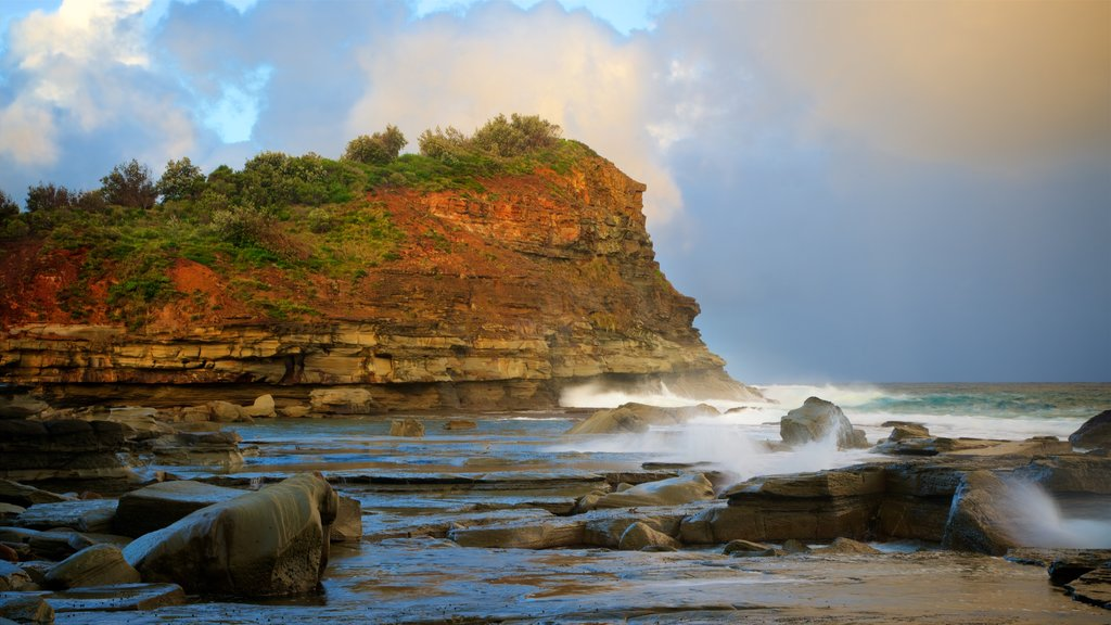 Terrigal showing waves, a sunset and rocky coastline