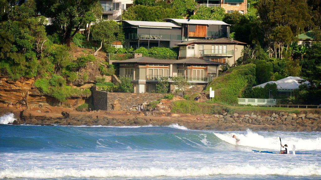 Avoca Beach which includes rugged coastline, surf and a coastal town