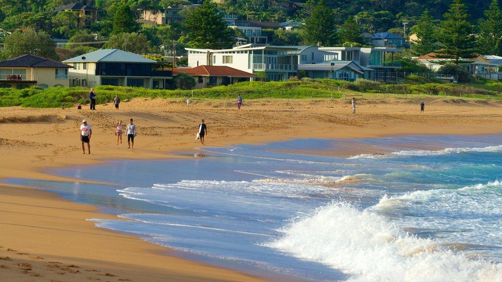 Avoca Beach which includes a bay or harbor, a coastal town and a sandy beach