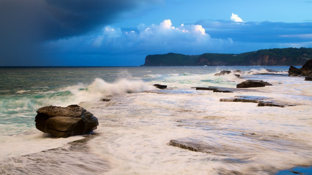 Terrigal which includes rugged coastline, a bay or harbor and surf