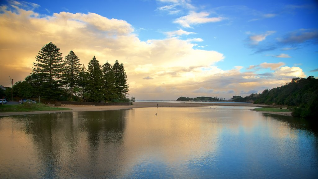 Terrigal featuring a sunset and a bay or harbor