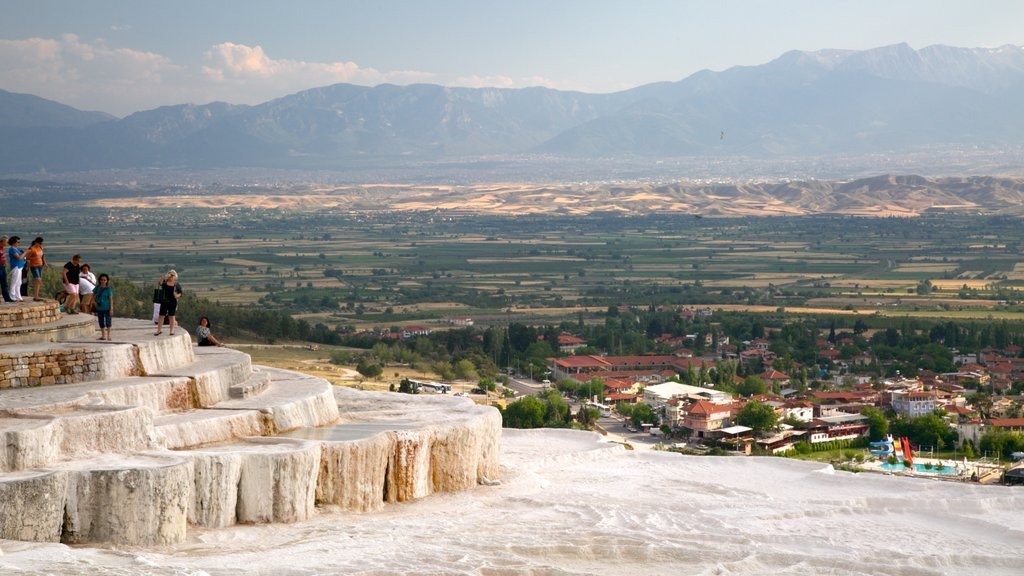 Pamukkale Thermal Pools which includes a hot spring as well as a small group of people