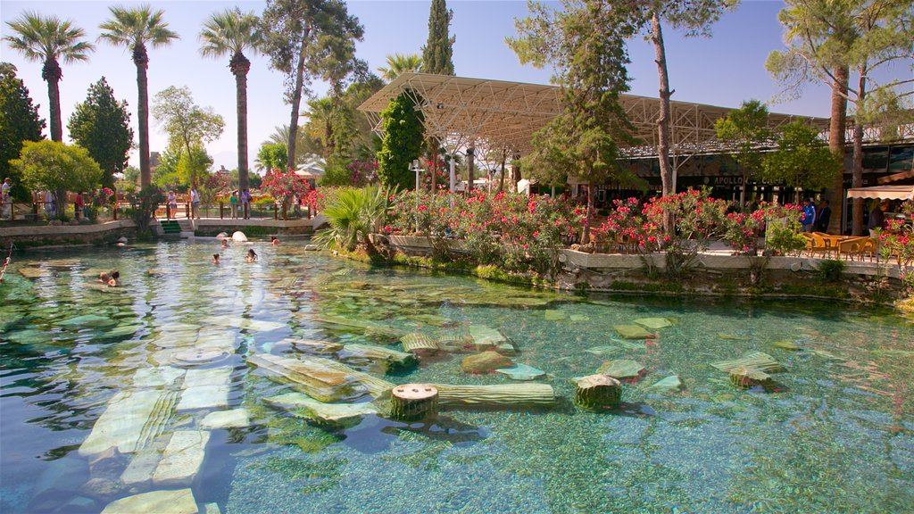 Hierapolis featuring a pool and a hot spring as well as a small group of people
