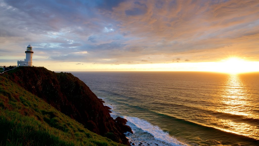 Cape Byron Lighthouse featuring a sunset and rugged coastline
