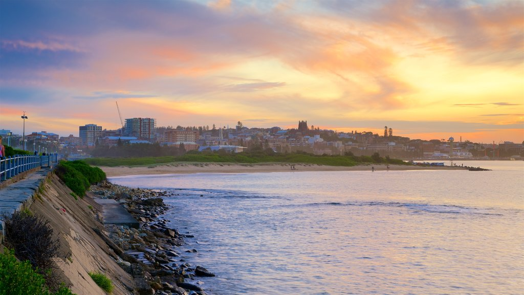 Newcastle featuring a beach, city views and a sunset