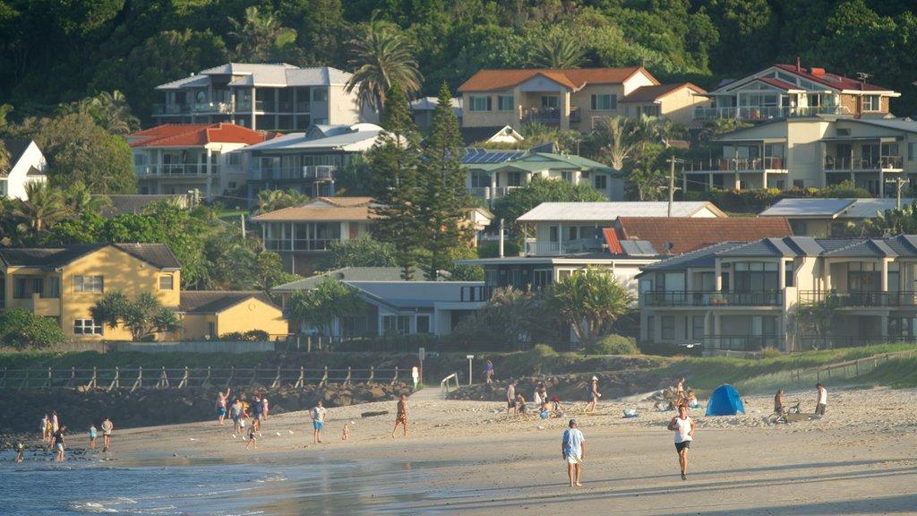 Lennox Head which includes a coastal town and a sandy beach