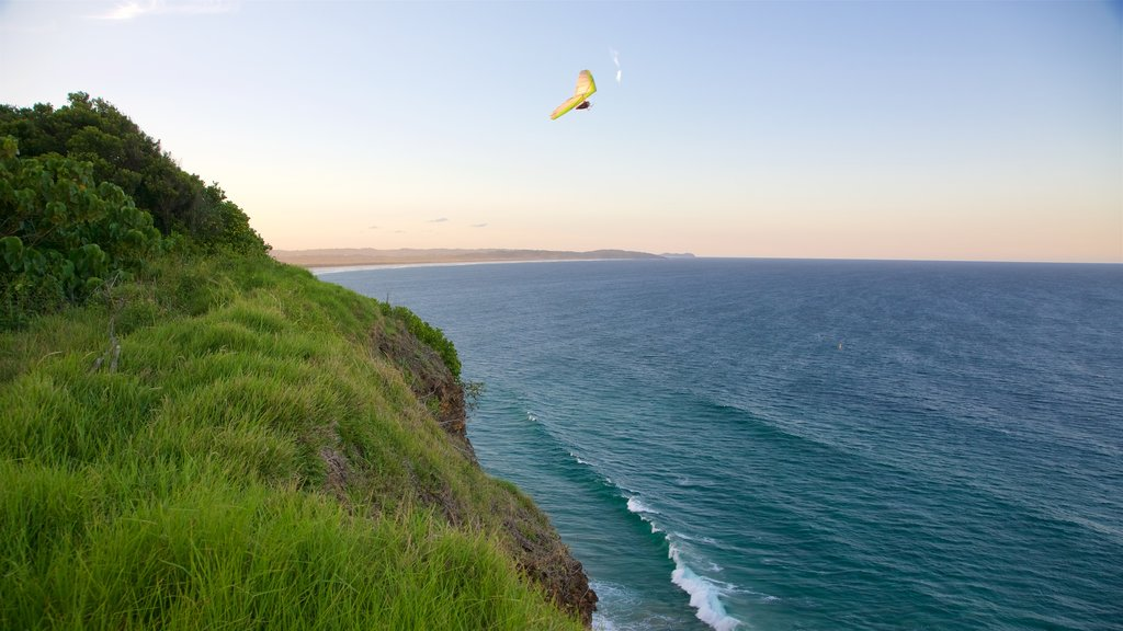 Lennox Head showing rocky coastline and parasailing