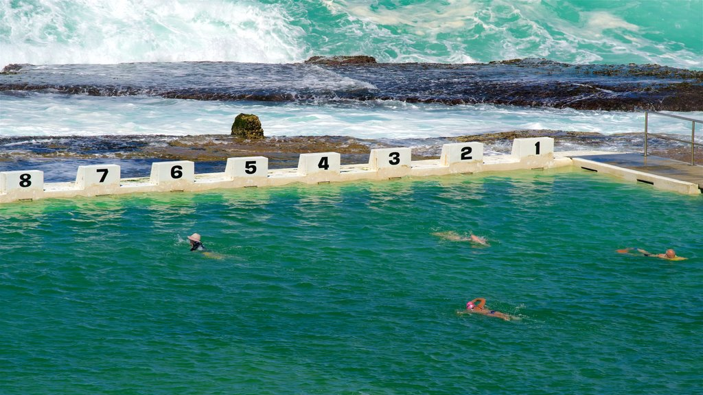 Newcastle showing surf, rocky coastline and a pool
