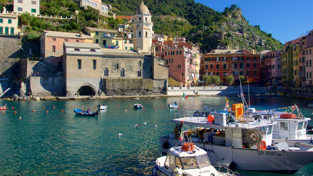 Vernazza which includes a coastal town, a bay or harbor and boating