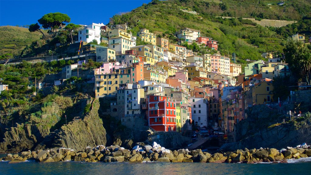 Riomaggiore which includes rugged coastline, a coastal town and mountains