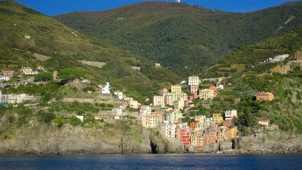 Riomaggiore featuring mountains, rugged coastline and a coastal town