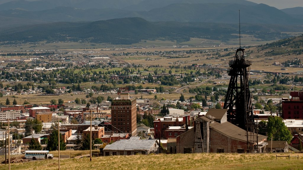 Butte showing tranquil scenes and a small town or village