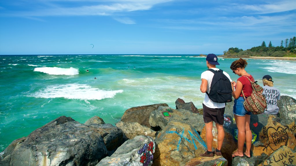 Port Macquarie showing rocky coastline, outdoor art and a bay or harbor