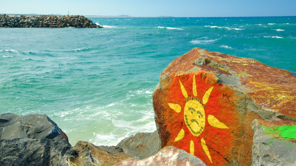 Port Macquarie showing outdoor art, a bay or harbor and rugged coastline