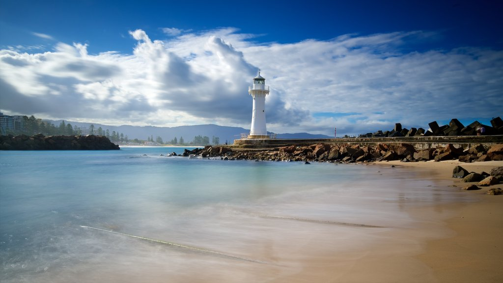 Flagstaff Hill Fort featuring a lighthouse, rocky coastline and a sandy beach