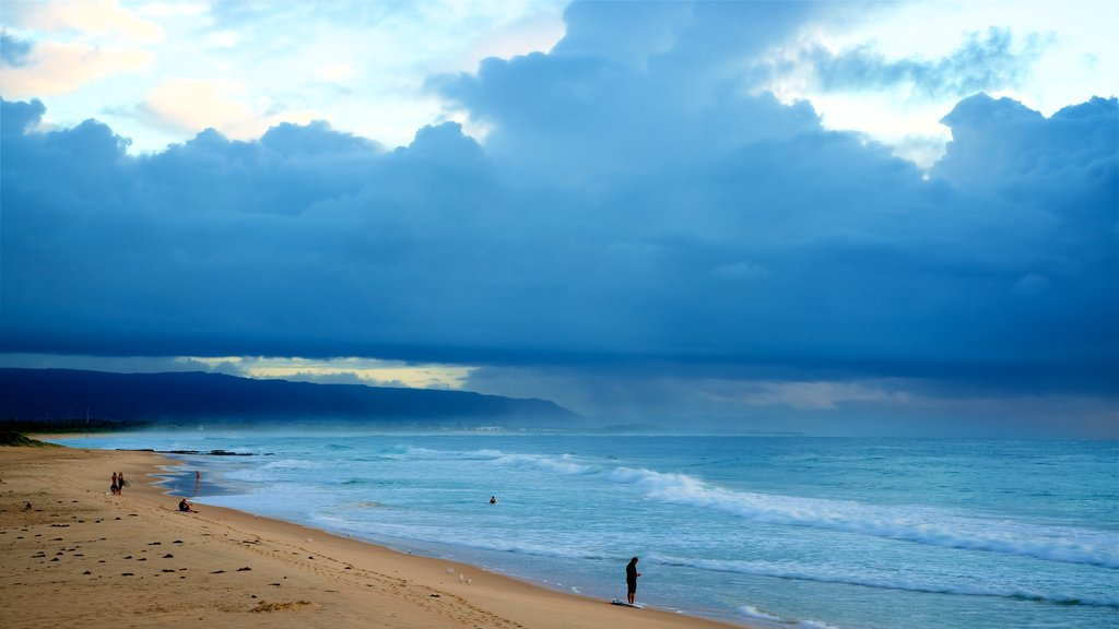 North Wollongong which includes general coastal views, a sunset and a beach