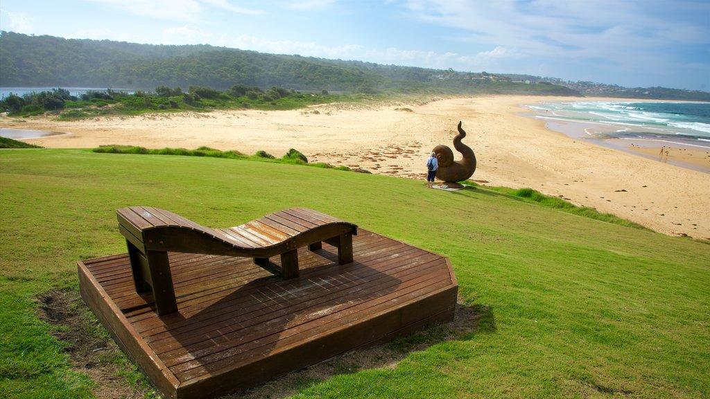 Merimbula showing outdoor art, a beach and general coastal views