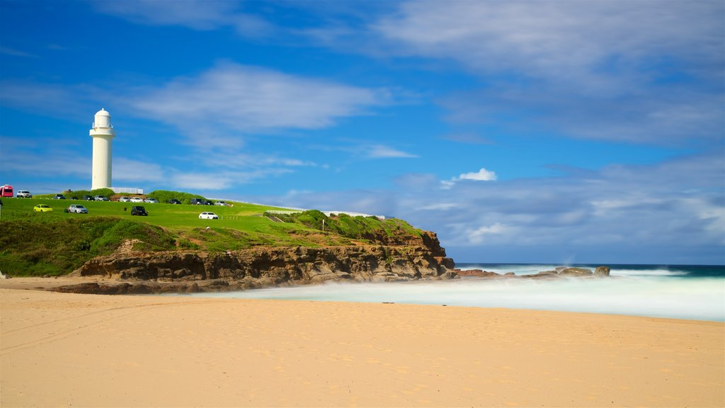 Wollongong South Beach featuring a sandy beach, general coastal views and a lighthouse