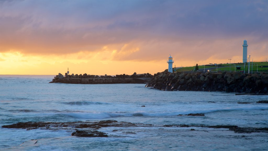North Wollongong featuring a sunset, a lighthouse and general coastal views
