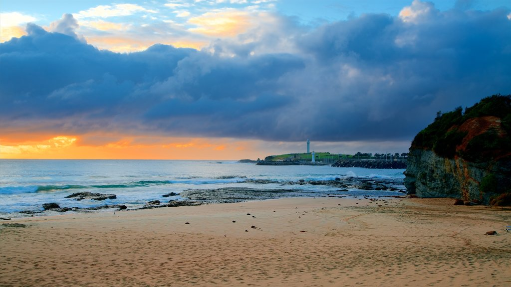 Wollongong North Beach which includes a sandy beach, general coastal views and a sunset