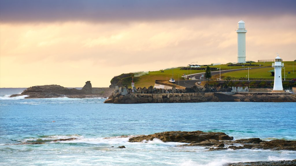 North Wollongong featuring a lighthouse, rugged coastline and general coastal views
