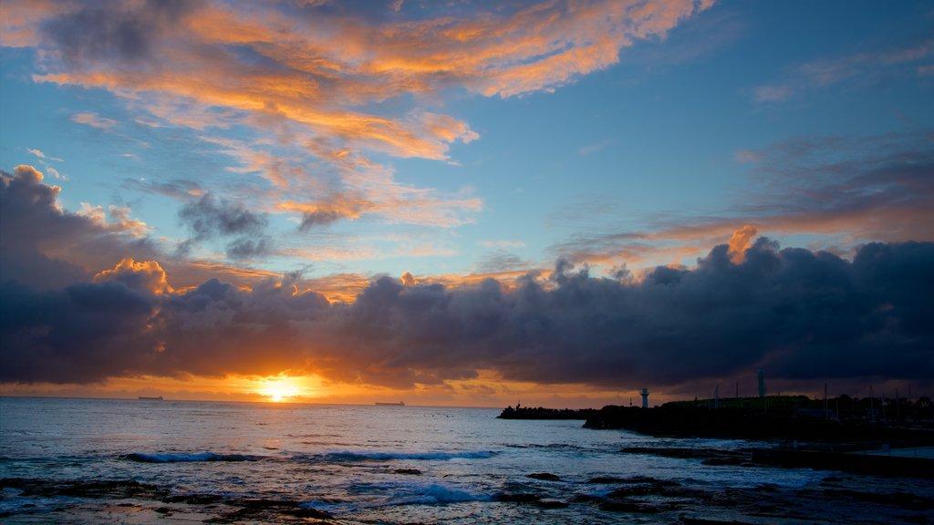 North Wollongong featuring a sunset and general coastal views