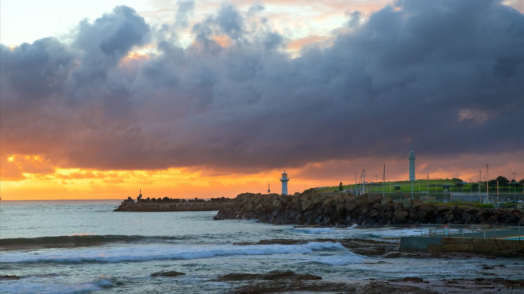 North Wollongong featuring rocky coastline, a sunset and general coastal views