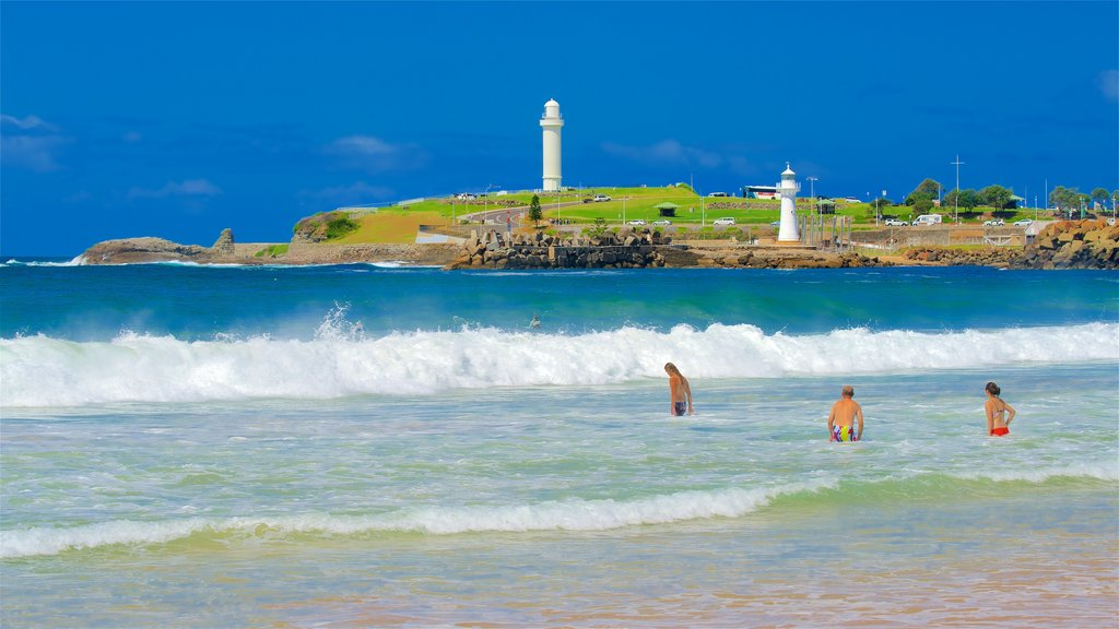 North Wollongong which includes general coastal views, surf and a lighthouse