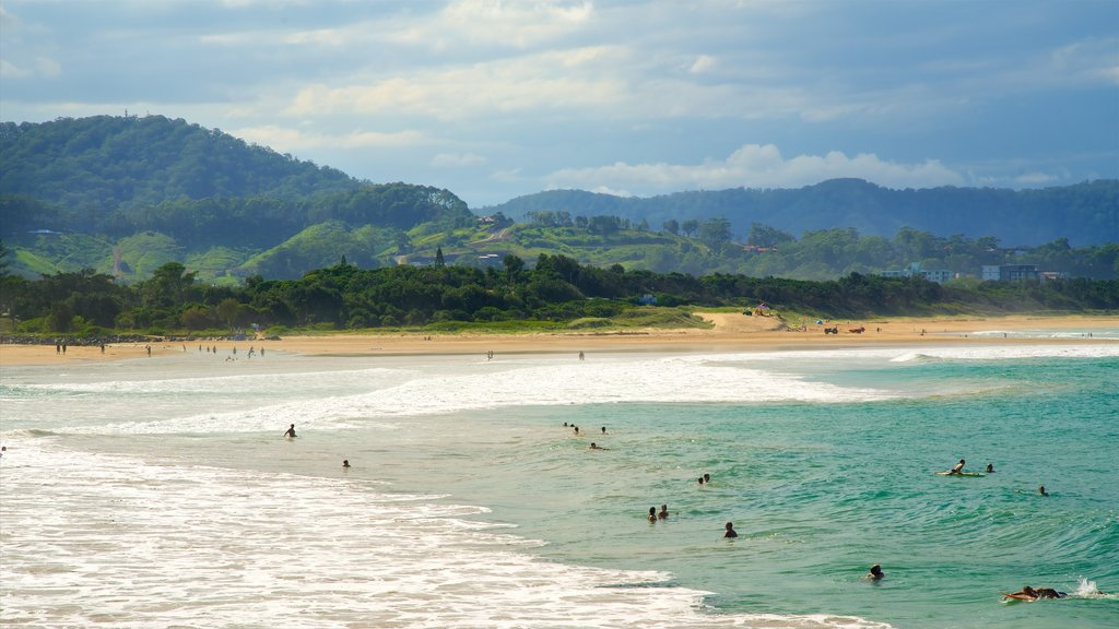 Coffs Harbour which includes swimming and a beach as well as a large group of people