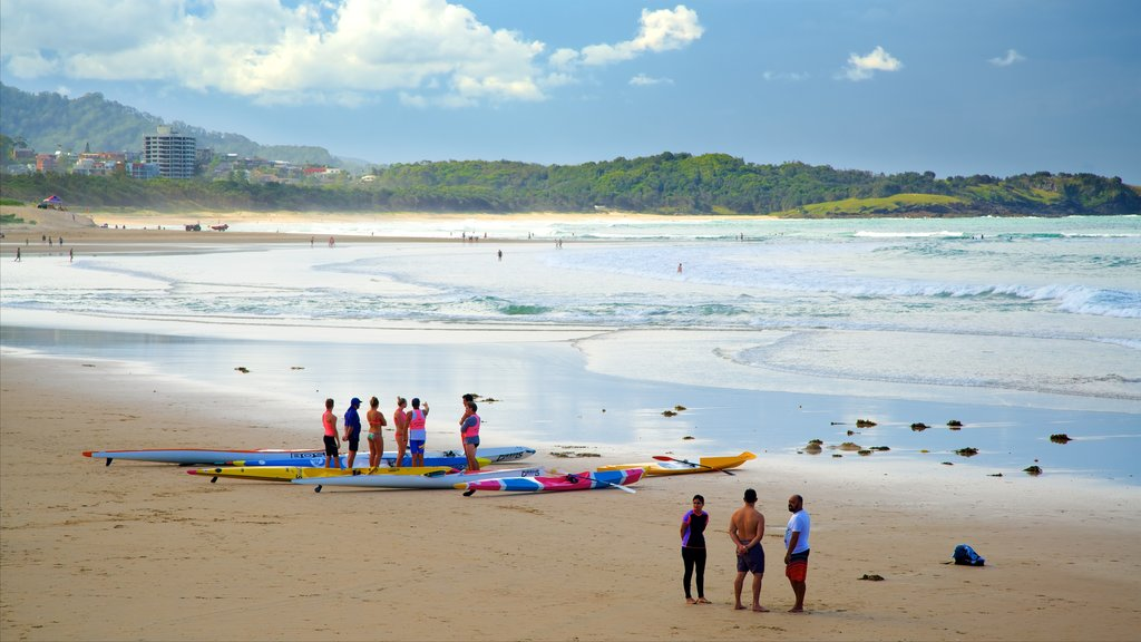 Coffs Harbour featuring kayaking or canoeing and a beach as well as a small group of people