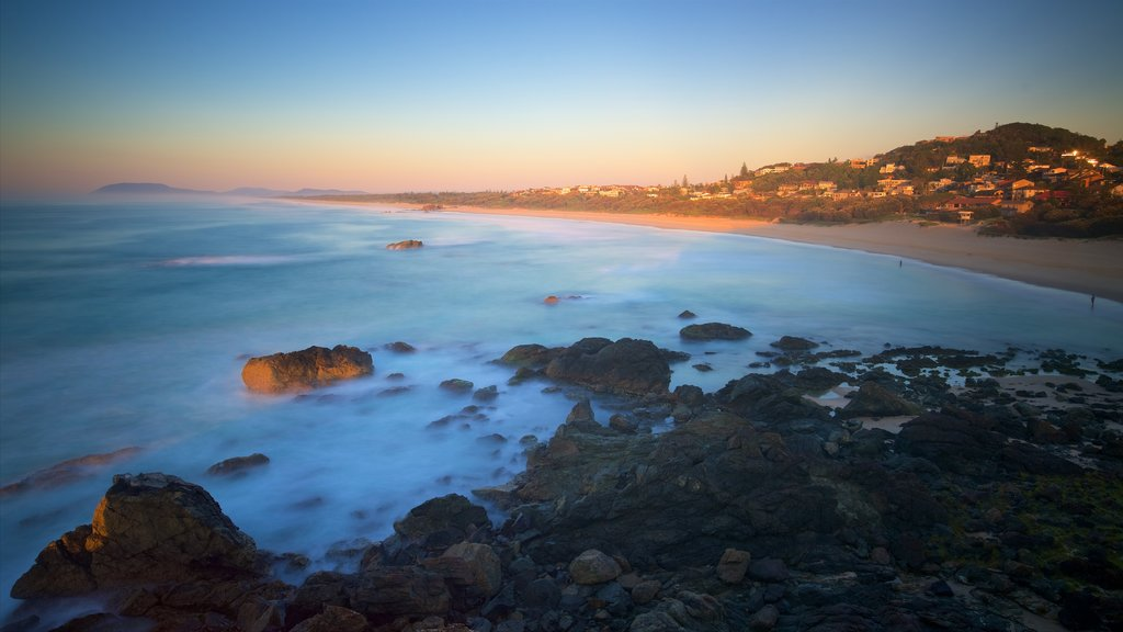 Port Macquarie showing rugged coastline, a sunset and a beach