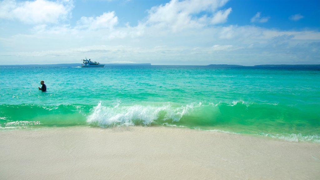 Huskisson which includes a sandy beach and general coastal views as well as an individual male