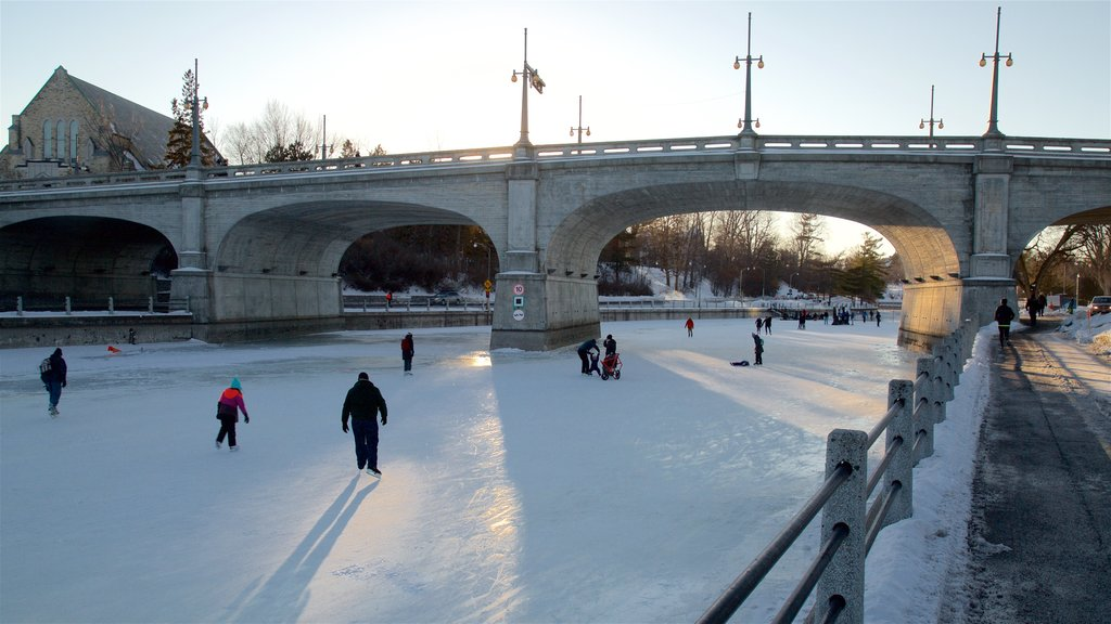 Rideau Canal showing a bridge, snow and ice skating