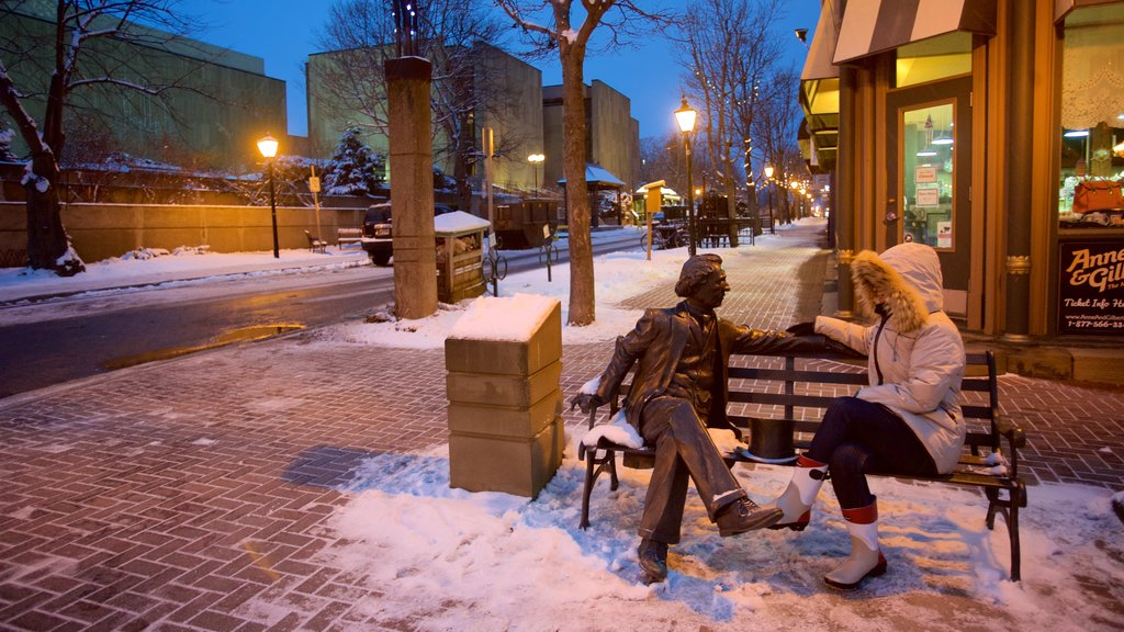 Charlottetown featuring outdoor art and street scenes as well as an individual femail