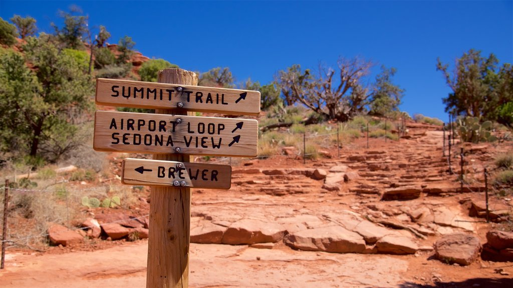 Sedona featuring signage and desert views