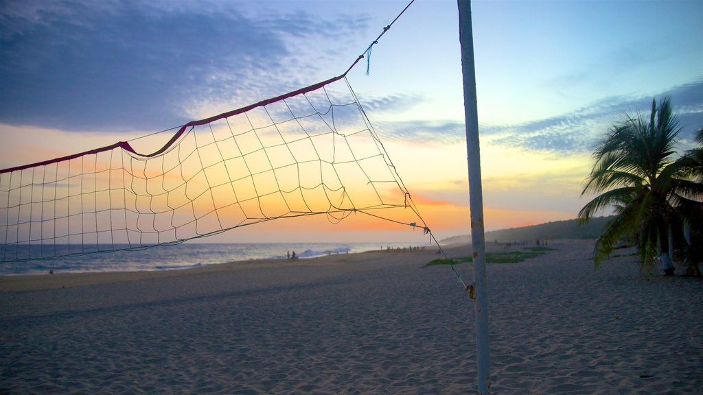 Oaxaca featuring a sandy beach, a sunset and a bay or harbor
