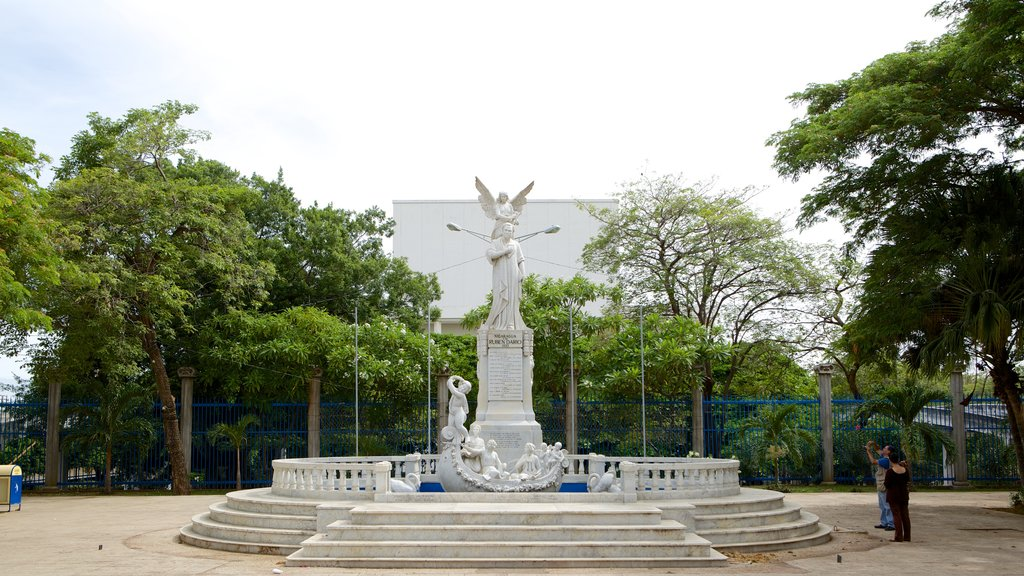 Managua showing a statue or sculpture as well as a couple
