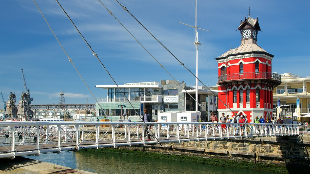 Victoria and Alfred Waterfront which includes a bridge, a river or creek and a lighthouse