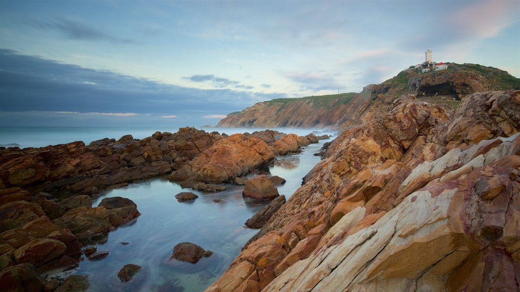 Garden Route featuring a sunset, general coastal views and rocky coastline