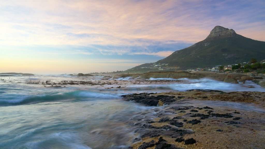 Camps Bay Beach which includes surf, coral and a sunset